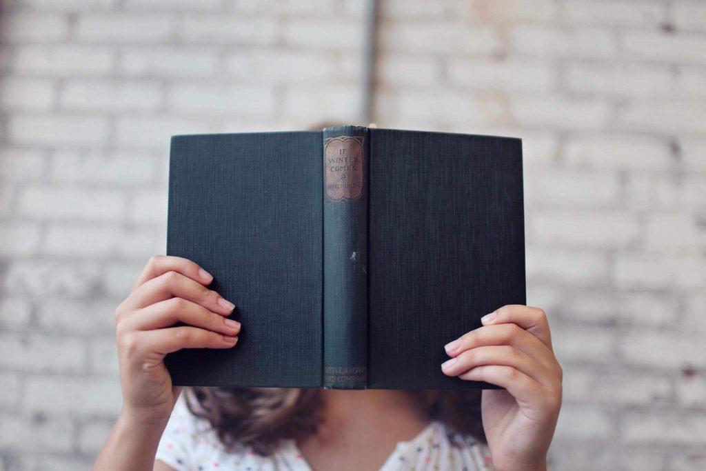 women holding book