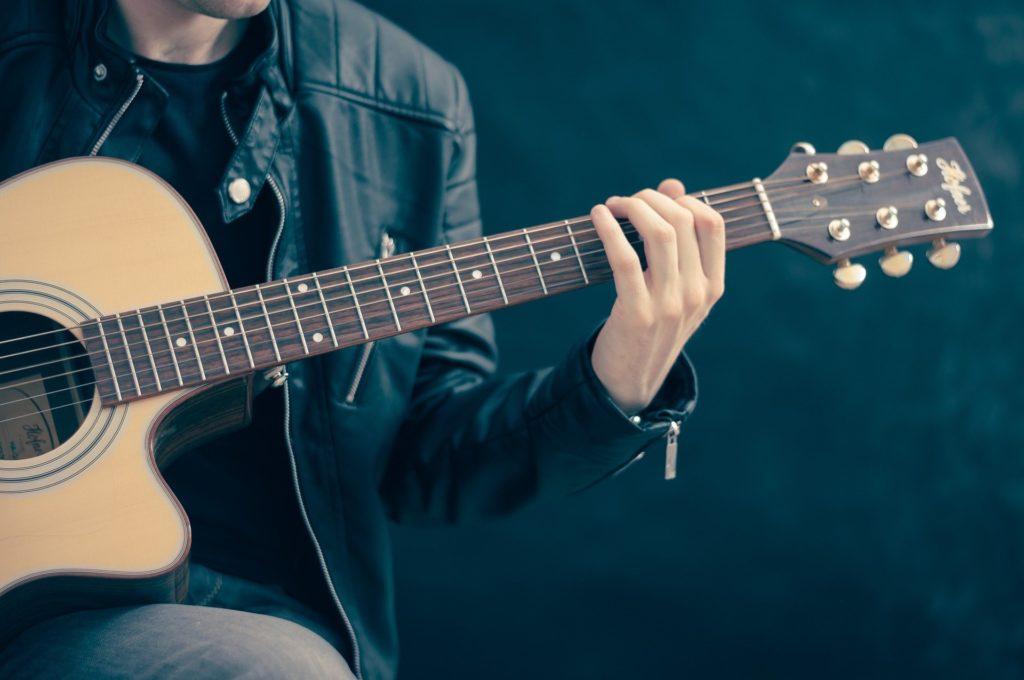 guy playing guitar - Savannah Music
